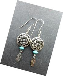 Turquoise stone, feather charms, basket bead and sterling