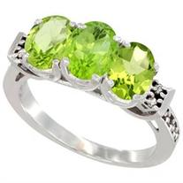 14K White Gold Natural Peridot Ring 3-Stone 7x5 mm Oval